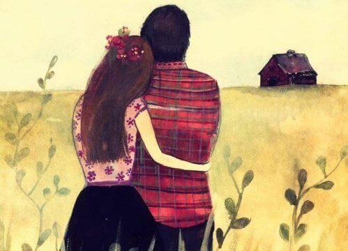 Par står sammen på en åker
