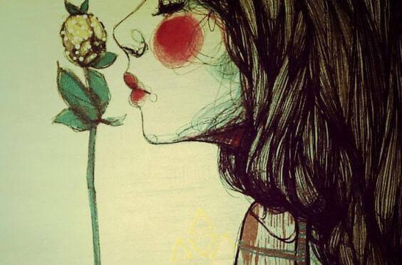 kvinne-lukter-blomst
