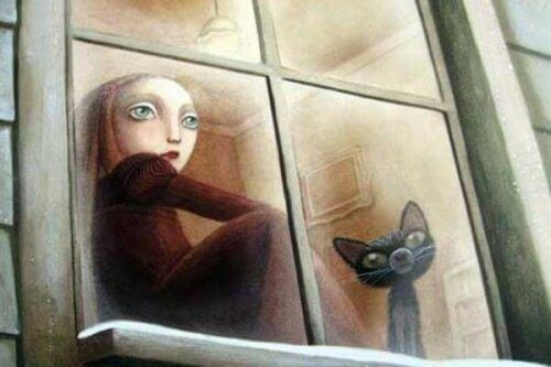 barn-med-katt-i-vinduet