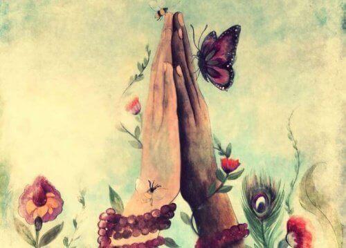 Hender med sommerfugl og blomster