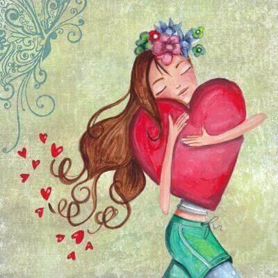 jente holder hjerte