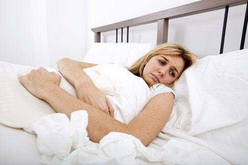 Kvinne med smerter