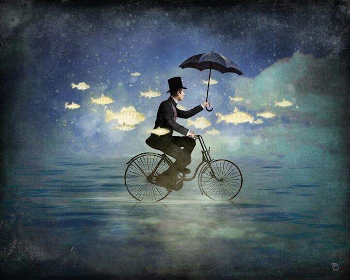 Mann på sykkel med paraply Christian Schloe