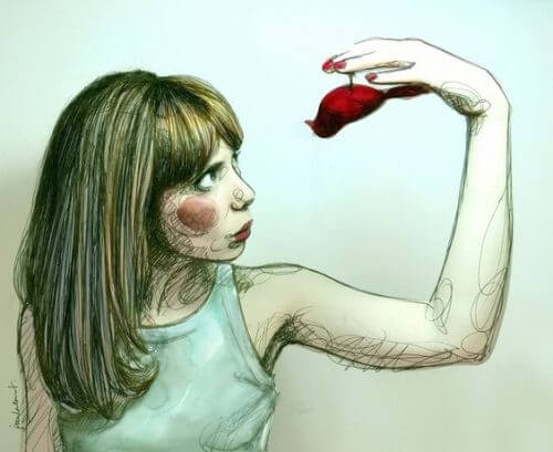 Kvinne holder rød fugl