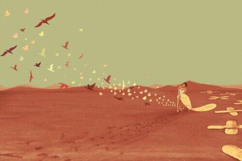 Kvinne følger fugler