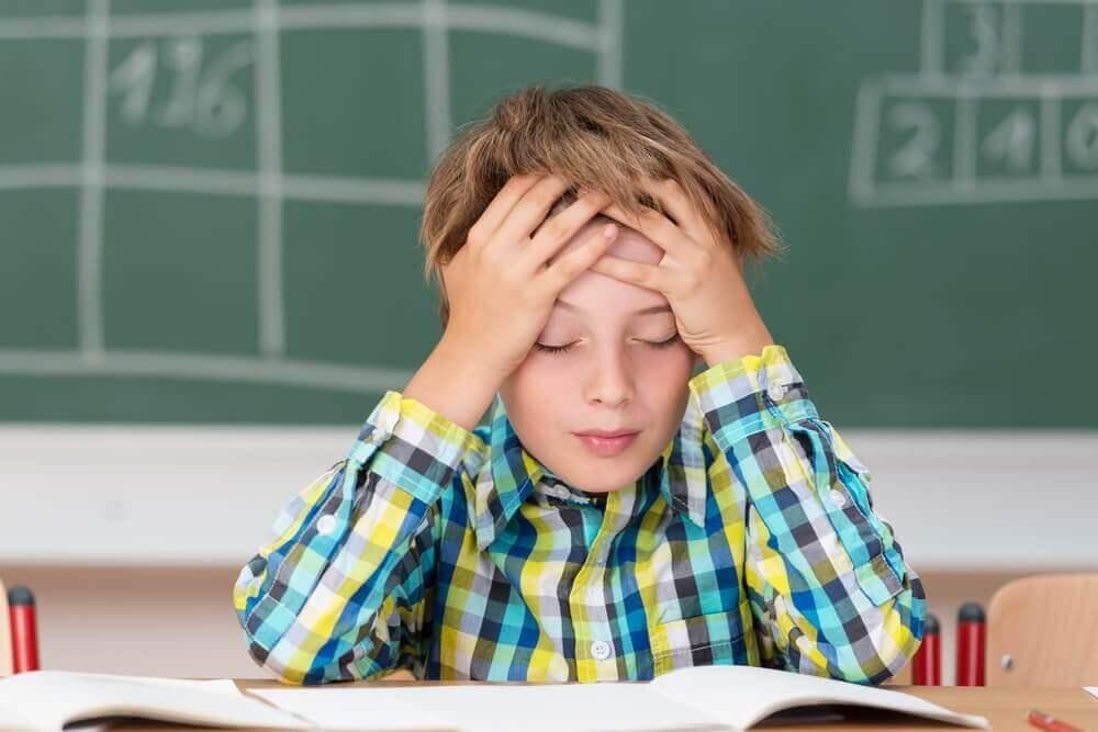 Barn med hodepine