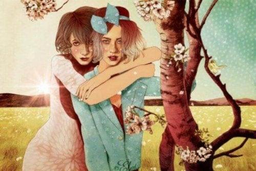 Kvinner ute under et tre