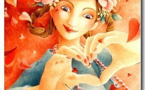 Kvinne former hjerte med hendene