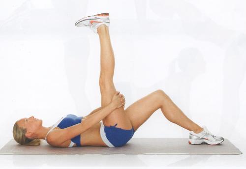 Utfør lårstrekk for å styrke ryggraden din
