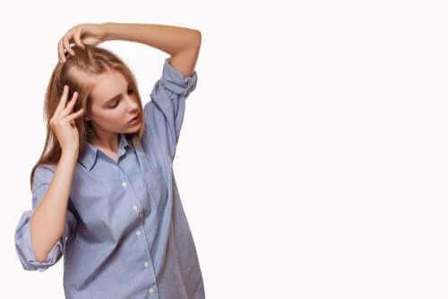 En kvinne med hårtap