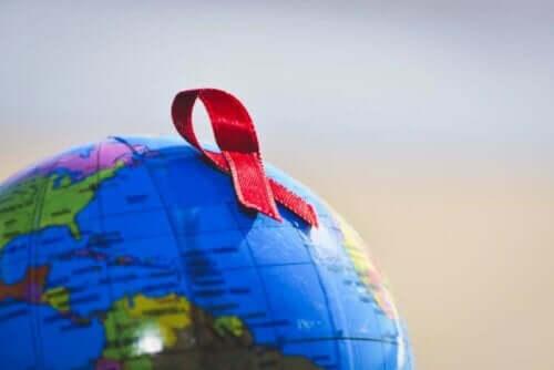 Rød sløyfe på en globus