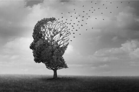 Et tre i form av et hode som mister bladene.