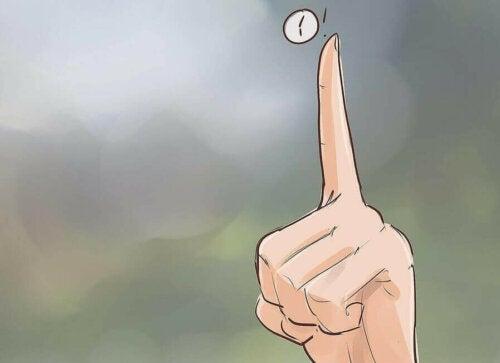 Finger som peker.
