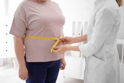 Overvekt kan være en av årsakene til lumbago.